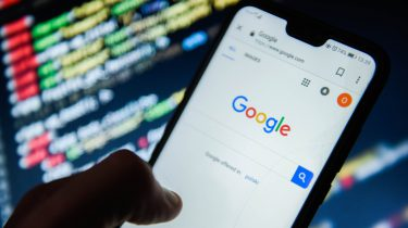 Person using Google on smartphone