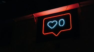 neon sign over social media
